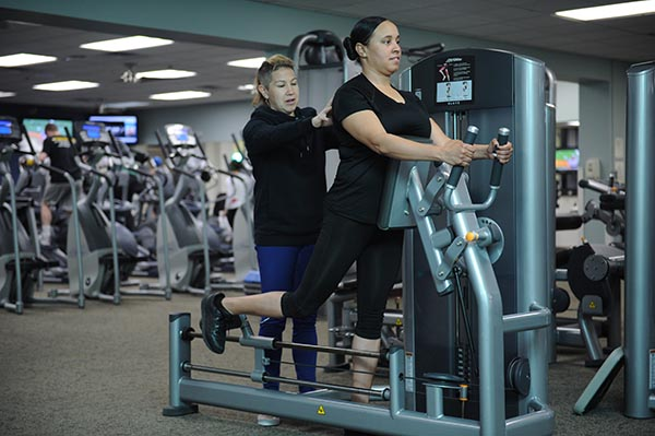 Image of female fitness trainer working with a female client