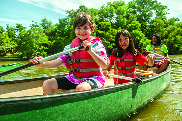 Two kids in a canoe on the lake