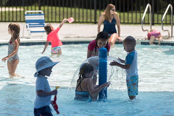 Image of kids playing in outdoor pool